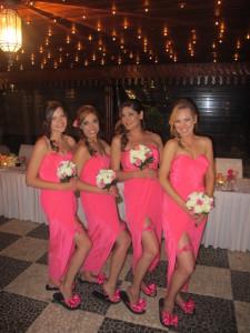 Four Bridesmaids in hot pink dresses, wearing their matching Bridal Flip Flops