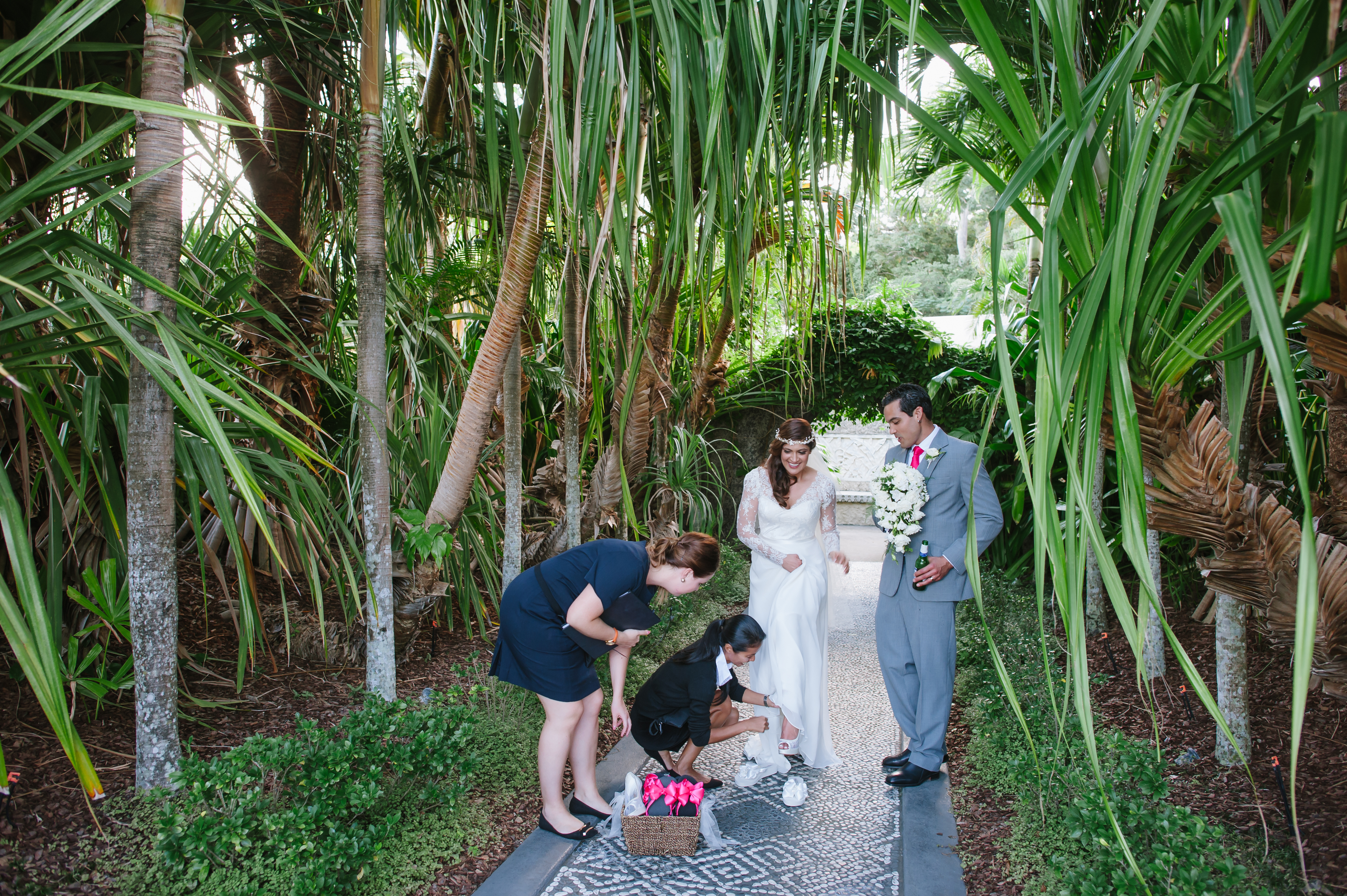 Bride slipping into her Bridal Flip Flops while her Groom watches