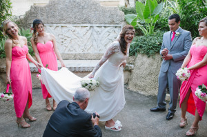 Bride showing her Bridal Flip Flop for her photographer