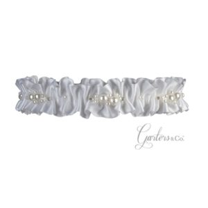 White garter made with pearls and rhinestones