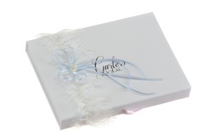 Jessica Silk White Lace Wedding Garter with a large blue bow and cream pearls