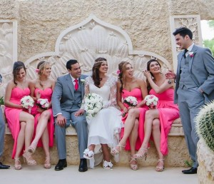 Bride and Groom sitting on a huge seat with their Wedding Party