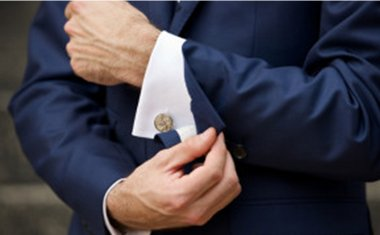 Cufflinks on a white shirt under the Grooms blue suit