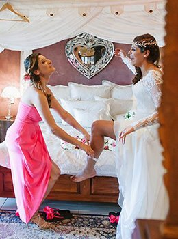 Bride slipping into her Wedding Garter