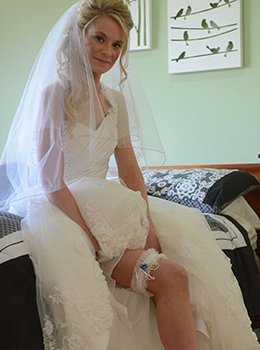 Sara wearing Wedding Garter with blue pearls